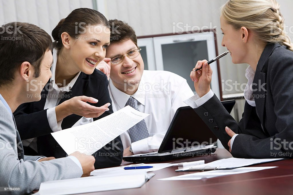 Individuals in business wear having a discussion royalty-free stock photo