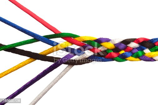 Individuals Joining Together As Team, Union, Family or Network. These colorful strings symbolize people joining together to form a tightly knit group or institution; bound together in unity of common purpose, and greater than the sum of it's parts.