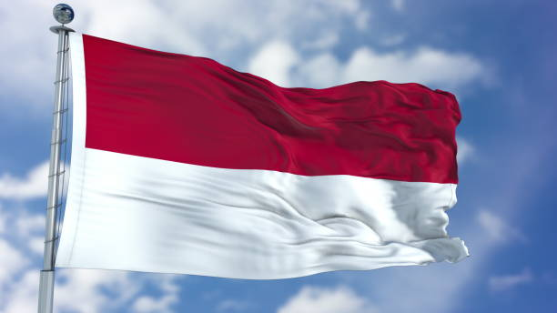 Indonesia Flag in a Blue Sky stock photo