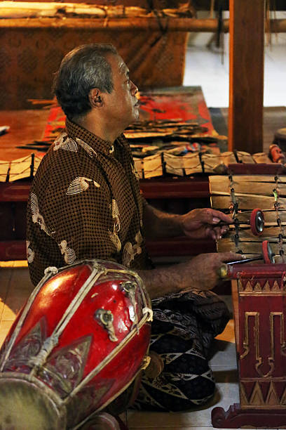 indonesia: gamelan performance at shadow puppet show - wayang kulit stock photos and pictures