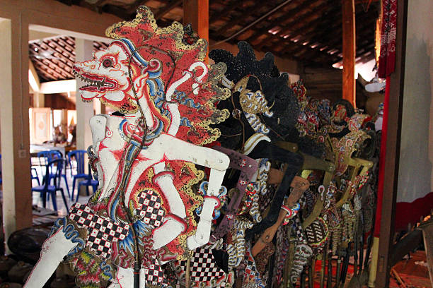 indonesia: javanese shadow puppets - wayang kulit stock photos and pictures