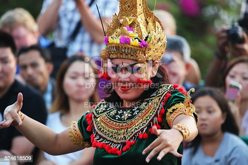 Uluwatu, Indonesia - August 22, 2014: A Balinese dancer performs in the Kecak ceremony. Also known as the Ramayana Monkey Chant, it is a retelling of a great battle from the Ramayana of Hindu lore.