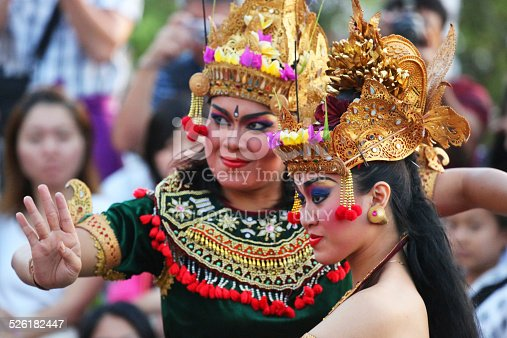 Uluwatu, Indonesia - August 22, 2014: Balinese dancers perform in the Kecak ceremony. Also known as the Ramayana Monkey Chant, it is a retelling of a great battle from the Ramayana of Hindu lore.