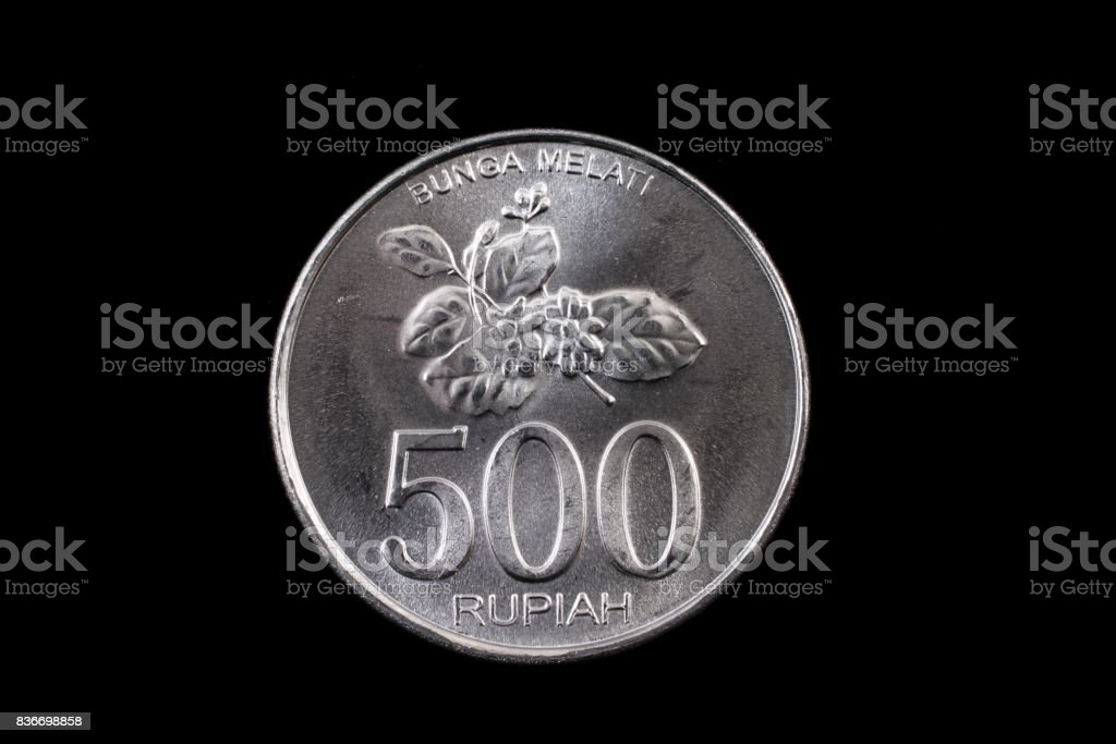 Indonesian 500 Rupiah coin close up on black stock photo