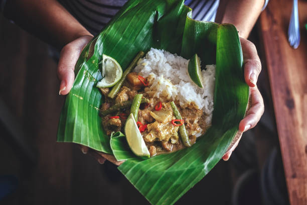 Indonesian Chicken Curry Dish with Rice Served on Banana Leaf Indonesian Chicken Curry Dish with Rice Served on Banana Leaf basmati rice stock pictures, royalty-free photos & images