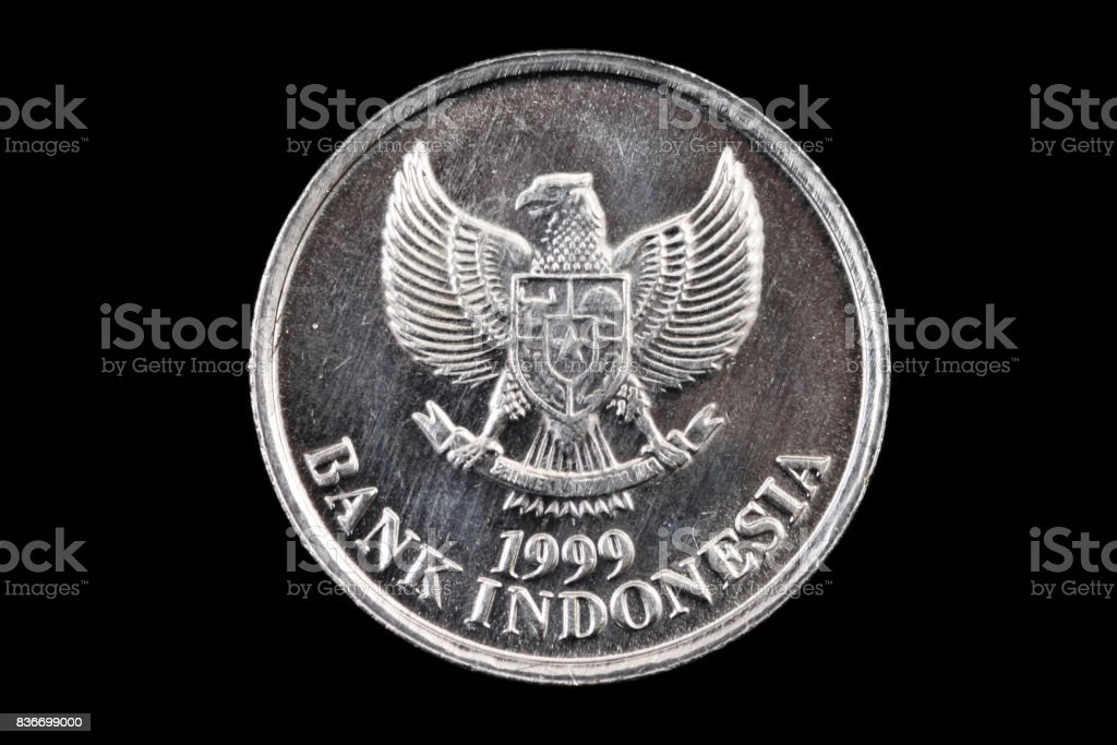 Indonesian coin close up on a black background stock photo
