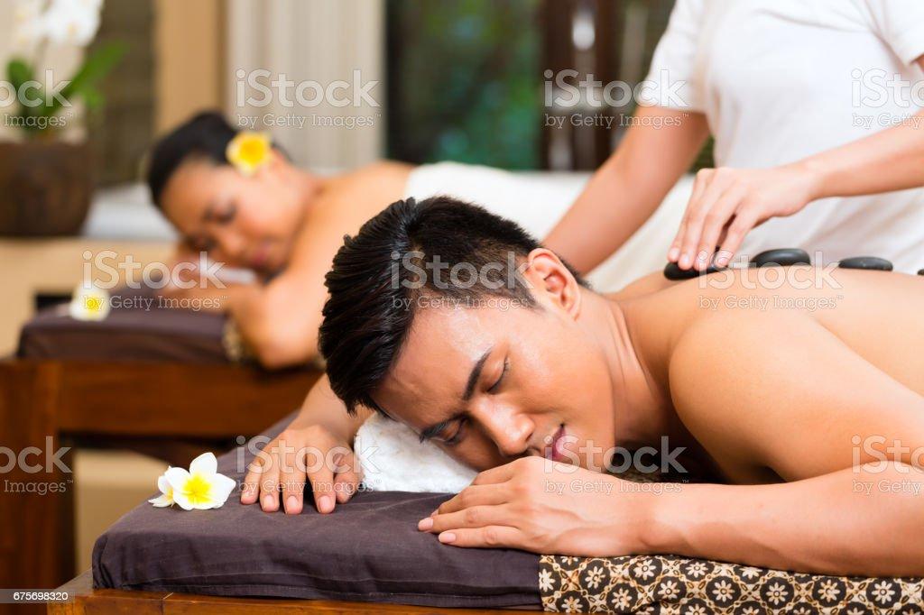 Indonesian couple having wellness massage royalty-free stock photo