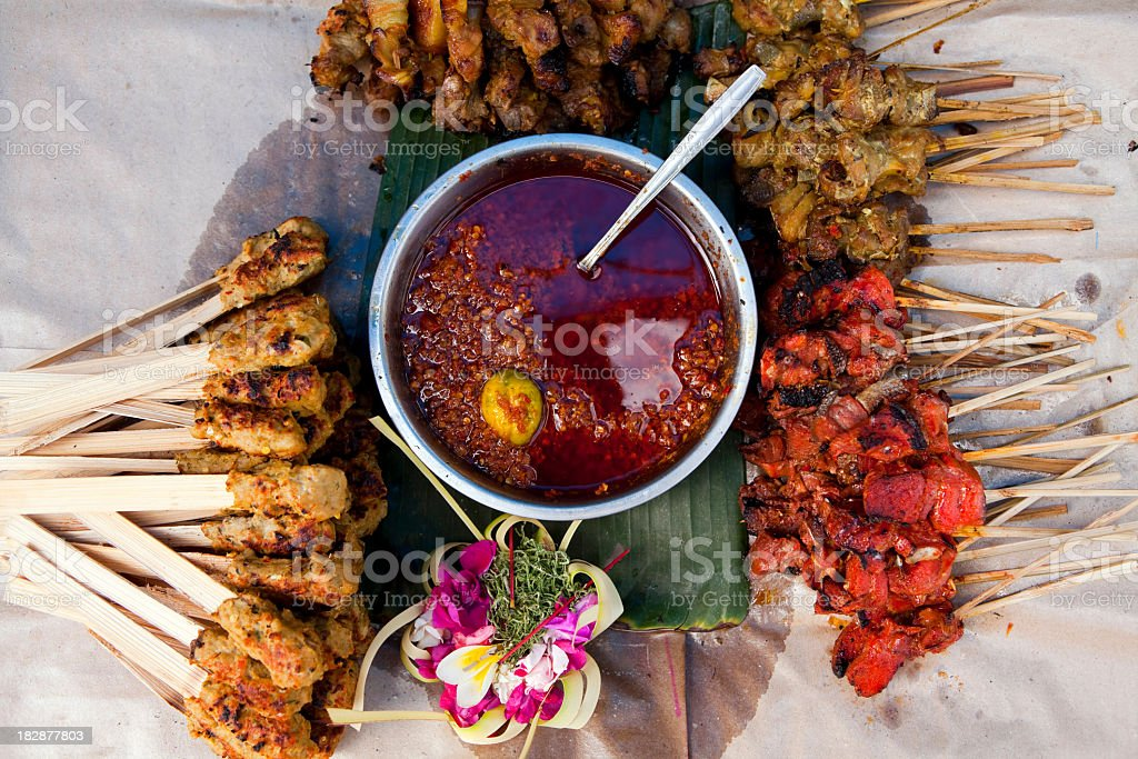 Indonesian dish with satay chicken skewers stock photo