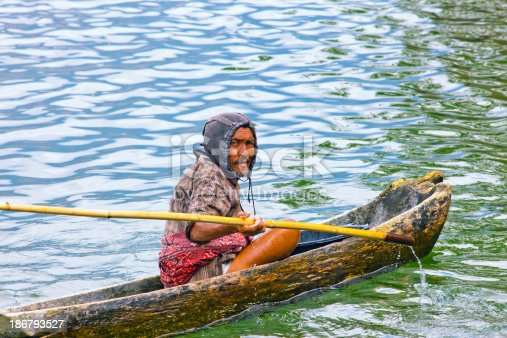 1030273092istockphoto Indonesian fisherman fishing on a boat 186793527