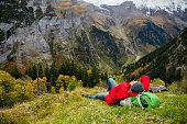 autumn season, murren, Switzerland, asian young man on hiking at alps mountain range