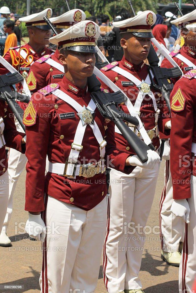 Indonesian Police Cadets Marching with Rifle royaltyfri bildbanksbilder