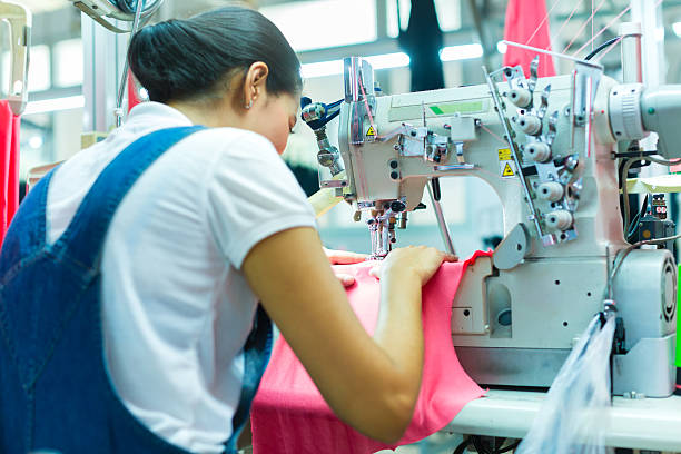 indonesian seamstress in a textile factory - garment stock photos and pictures