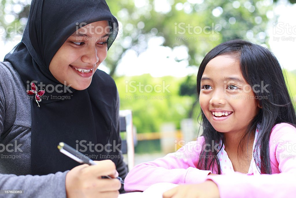 indonesian teacher and student royalty-free stock photo