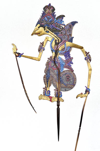 indonesian traditional wayang kulit  puppet hanging on white wall - wayang kulit stock photos and pictures