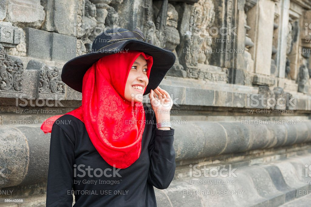 Indonesian Woman Visiting Ancient Ruins Prambanan Temple Compound in Java stock photo