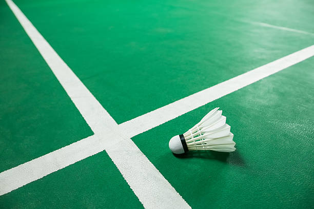 indoor badminton ball on green badminton court - badminton stock pictures, royalty-free photos & images