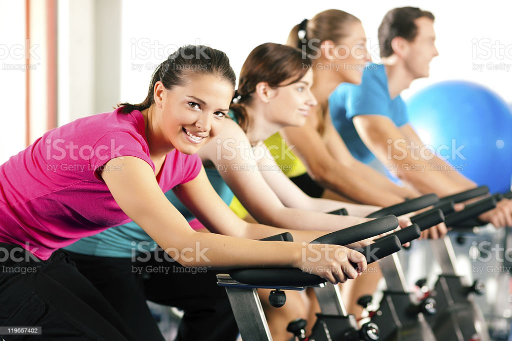 Indoor bycicle cycling in gym royalty-free stock photo