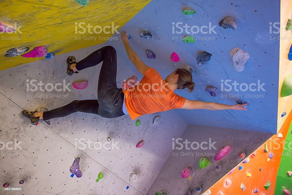 Indoor climbing girl stock photo