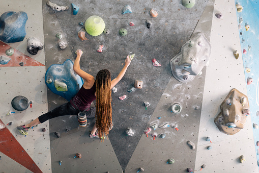 istock Indoor climbing in the bouldering gym wall. 607295744