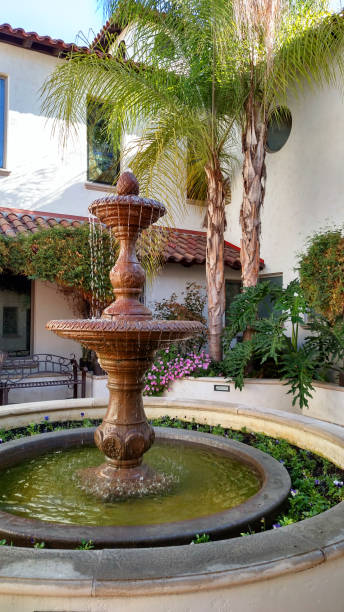 Indoor courtyard and fountain spanish-style architecture of church in Redlands California Indoor courtyard and fountain spanish-style architecture of church in Redlands California redlands california stock pictures, royalty-free photos & images