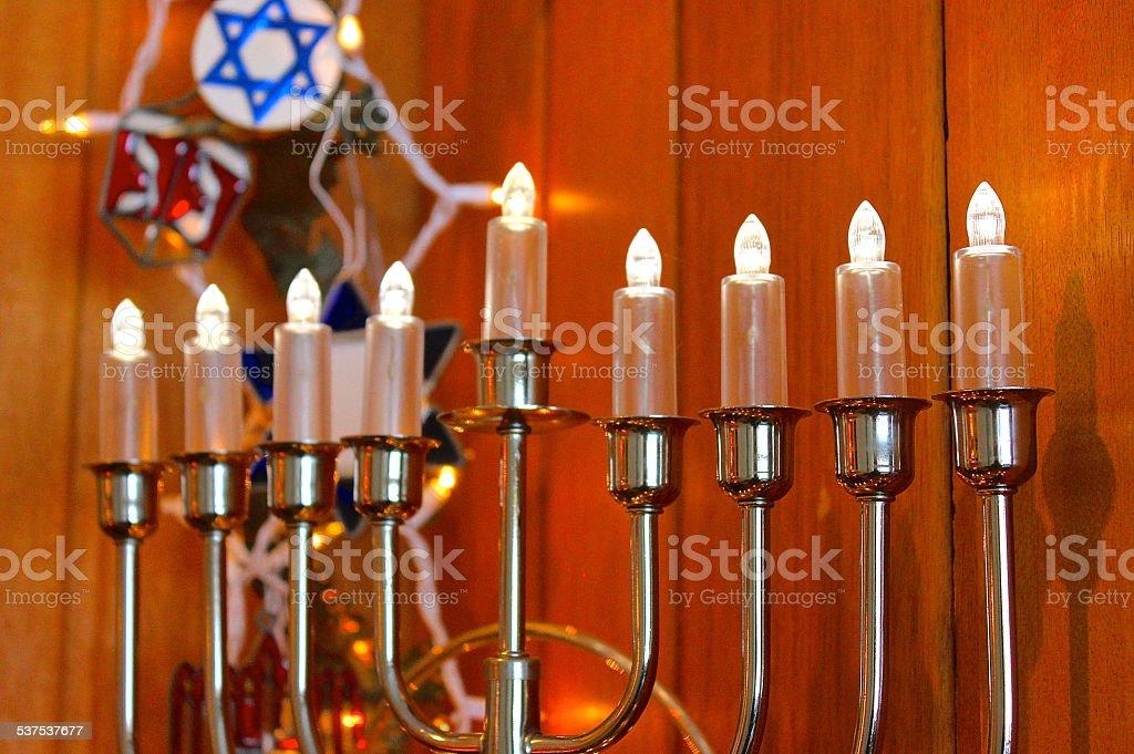 Indoor electric Hanukkah menorah and decorations stock photo