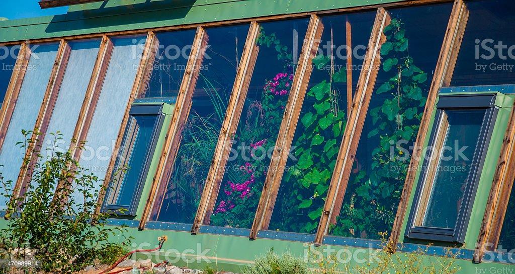 Indoor Greenhouse in a Earth Ship Free Sustainable Living stock photo