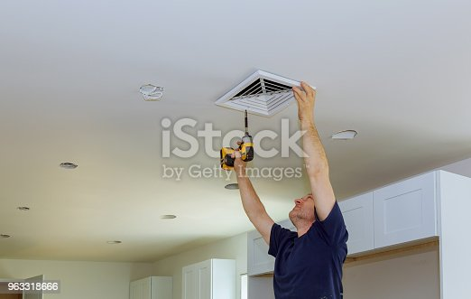 istock Indoor installing central air conditioning vents on the wall 963318666