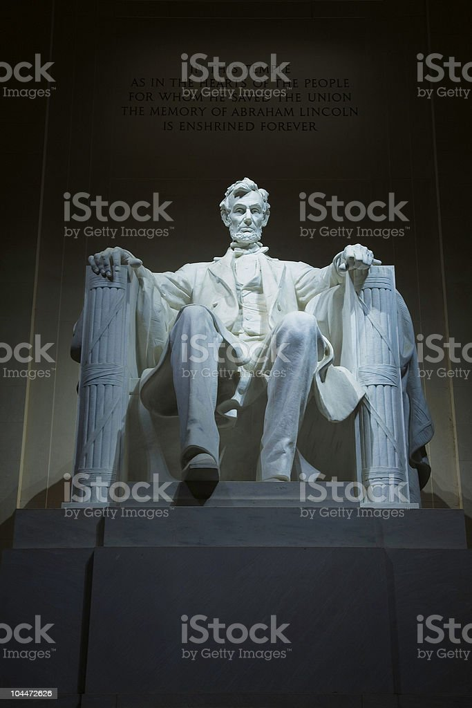 Indoor Lincoln Memorial statue in seated pose lit from above stock photo