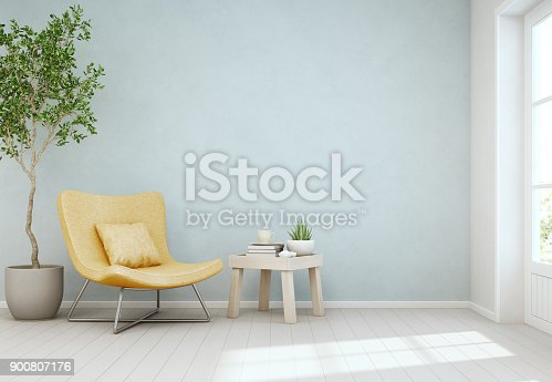istock Indoor plant and coffee table on wooden floor with empty blue concrete wall background, Yellow chair near door in bright living room of modern scandinavian house 900807176