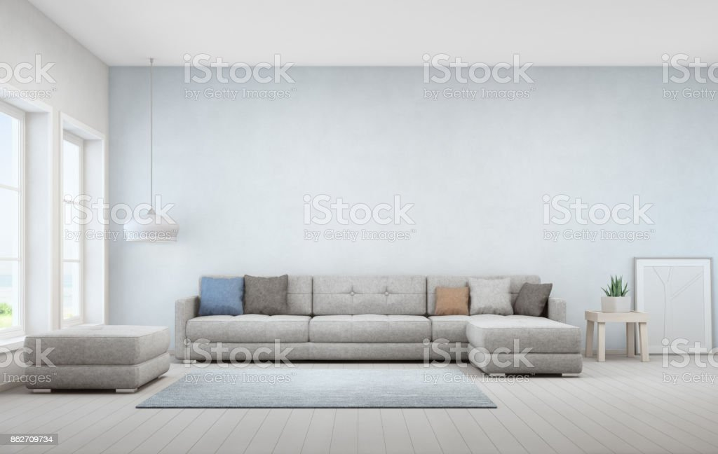Indoor Plant On Wooden Coffee Table And Big Sofa With Empty Blue Concrete  Wall Background,