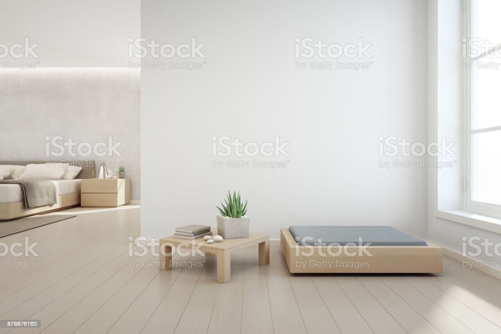 Indoor plant on wooden coffee table and modern furniture with empty white concrete wall background, Bedroom near living room in scandinavian house stock photo