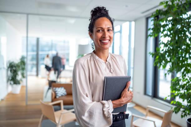 Indoor Portrait of Smiling Hispanic Businesswoman in Office stock photo