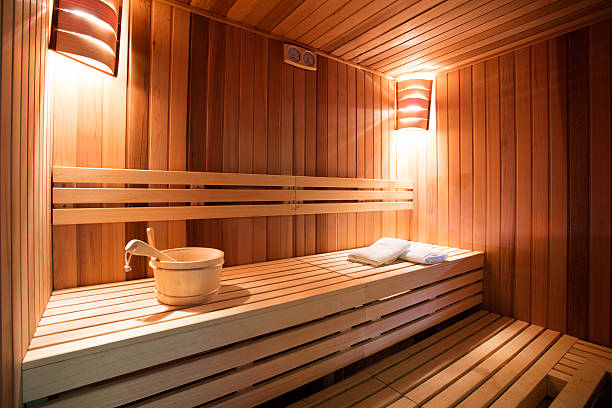 Sauna interior Sauna interior. Sauna is ready to receive guests. Photo made with available light, and with very nice warm tones.   sauna stock pictures, royalty-free photos & images