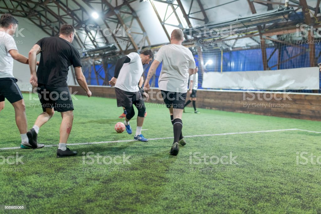 Soccer players training indoors