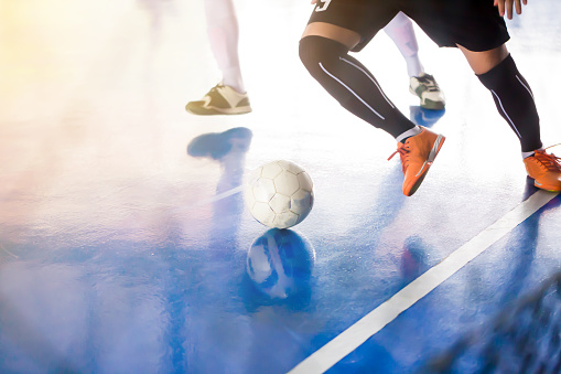 istock Indoor soccer sports hall and player. 1045481630
