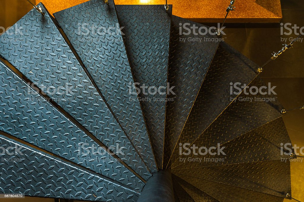 Indoor suspended steel spiral staircase stock photo