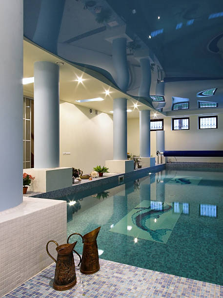 Indoor swimming pool and spa with reflective ceiling stock photo