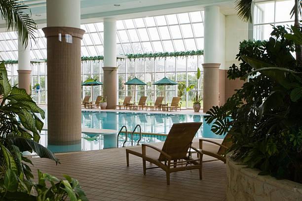 Indoor swimming pool at resort stock photo