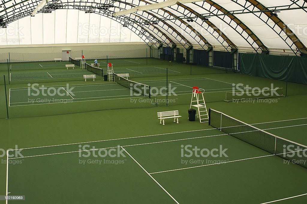 Indoor tennis court stock photo