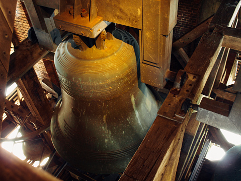 Indoor view of huge metallic bell, inside of church at Netherlnds