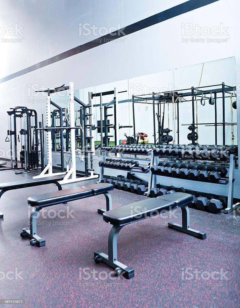 Indoor Weight Lifting Training Equipments in Interior Gymnasium Health Club stock photo