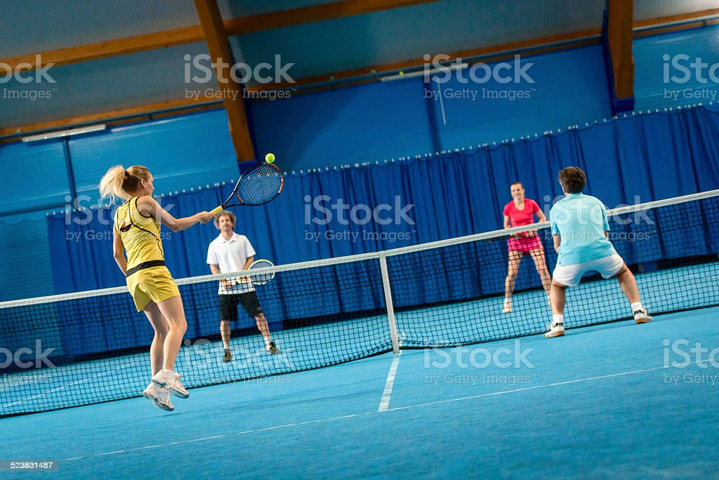 Indoors Mixed Doubles Match stock photo