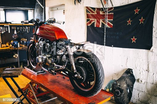 istock Indoors of custom motorcycle workshop 972556902