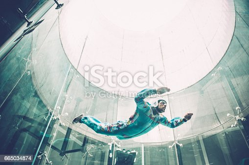 View through window - glass reflections. Indoor skydiving is the simulation of true freefall conditions in a vertical wind tunnel, Logatec, Slovenia, Europe. Copy space, No logo. Lens 24.0-70.0 mm f/2.8