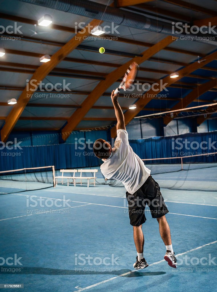 Indoors Tennis Serving Action stock photo