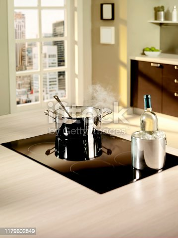 Induction stove with hot pan and ice cold wine