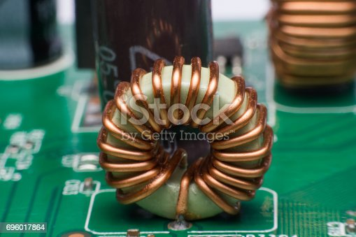 istock Inductor copper coils on the circuit board 696017864