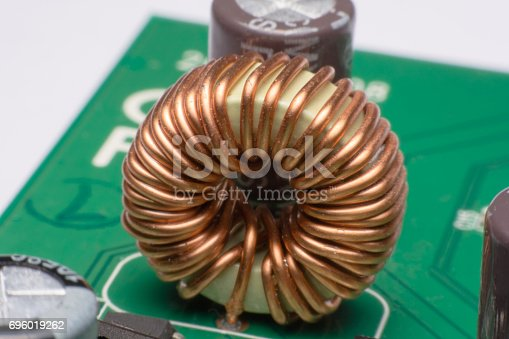 istock Inductor copper coils on the circuit board 696019262
