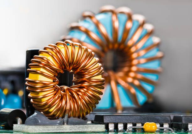Inductors detail. Copper wire winding. Coils. Magnetic ferrite core. Inverter stock photo