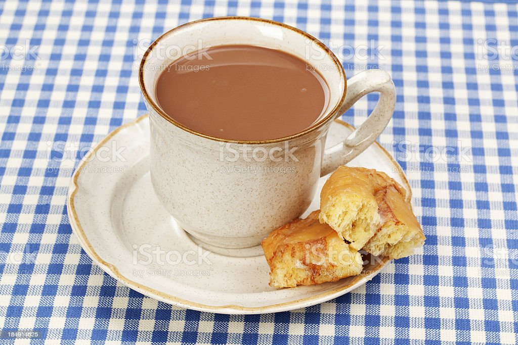 Indulgence: Rich Hot Chocolate with Cinnamon Roll stock photo